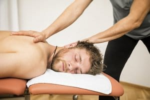 man enjoying massage therapy